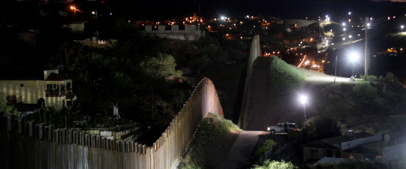 NOGALES, AZ - JULY 6: The border wall is illuminated at night July 6, 2012 in Nogales, Arizona. The president-elect of Mexico, Enrique Peña Nieto, stated that he wants to expand his country's drug-war partnership with the United States but that he would not support the presence of armed American agents in Mexico. (Photo by Sandy Huffaker/Getty Images)